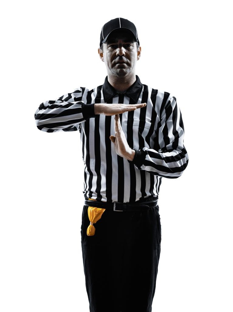 american football referee gestures time out silhouette